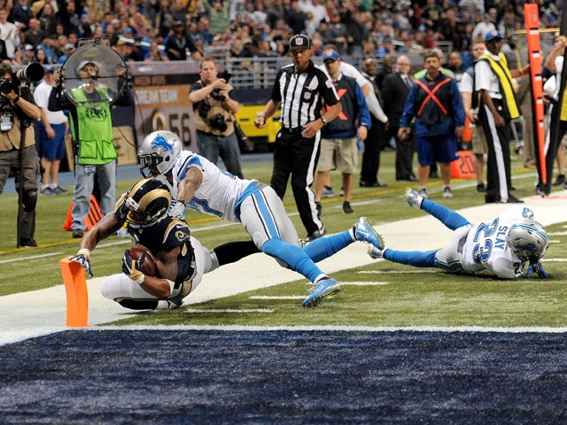 Todd Gurley #30 of the St. Louis Rams scores a touchdown in the fourth quarter against the Detroit Lions at the Edward Jones Dome on December 13, 2015