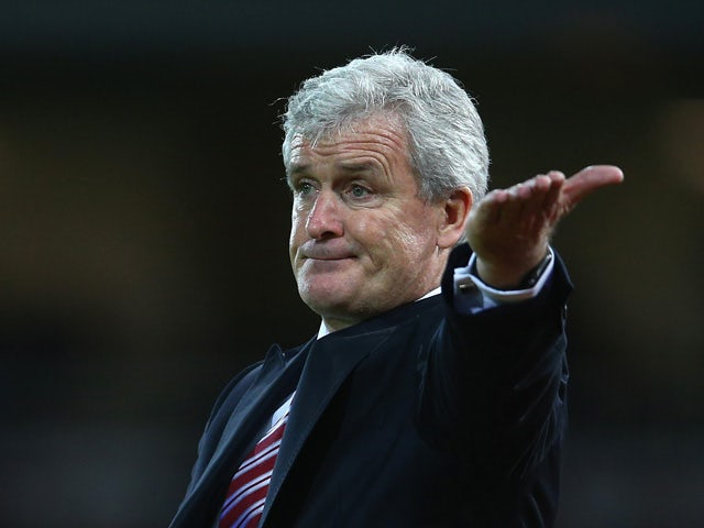 Mark Hughes manager of Stoke City gestures during the Barclays Premier League match between West Ham United and Stoke City at the Boleyn Ground on December 12, 2015