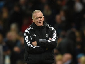 Alan Curtis caretaker Manager of Swansea City looks on during the Barclays Premier League match between Manchester City and Swansea City at Etihad Stadium on December 12, 2015