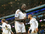 Bafetimbi Gomis of Swansea City celebrates scoring his team's first goal during the Barclays Premier League match between Manchester City and Swansea City at Etihad Stadium on December 12, 2015