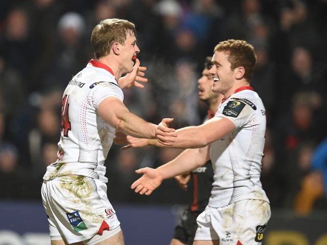 Andrew Trimble (L) of Ulster celebrates with team mate Paddy Jackson (R) after scoring a try during the European Champions Cup Pool 1 rugby game between Ulster and Toulouse at Kingspan Stadium on December 11, 2015