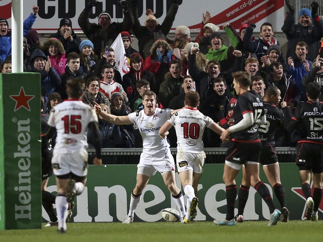 Ulster's Irish wing Andrew Trimble (C) celebrates scoring a try during the European Rugby Champions Cup pool rugby union match between Ulster Rugby and Stade Toulousain at the Kingspan Stadium in Belfast, Northern Ireland, on December 11, 2015