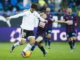 Andres Gomes of Valencia CF duels for the ball with Gonzalo Escalante of SD Eibar during the La Liga match between SD Eibar and Valencia CF at Ipurua Municipal Stadium on December 13, 2015 in Eibar, Spain.