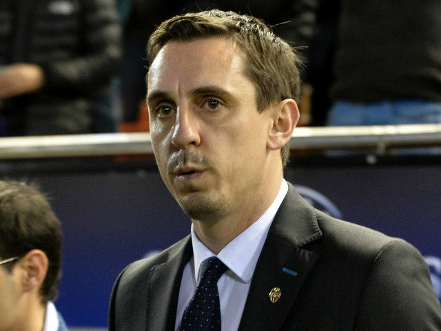 Valencia's Britihs coach Gary Neville gestures from the sideline during the UEFA Champions League football match Valencia CF vs Olympique Lyonnais at the Mestalla stadium in Valencia on December 9, 2015.