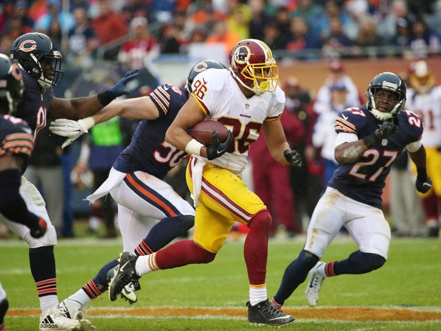 Jordan Reed #86 of the Washington Redskins runs for 32 yards during the third quarter at Soldier Field on December 13, 2015