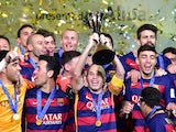 Barcelona captain Andres Iniesta raises the Club World Cup trophy on December 20, 2015