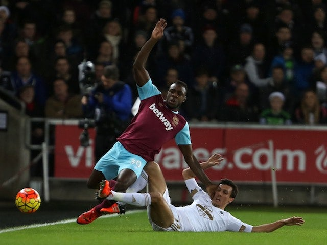 Swansea's Jack Cork and West Ham's Michail Antonio tussle on December 20, 2015