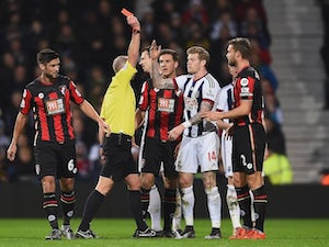 James McClean of West Brom is shown the red card by referee Mike Dean during the game with Bournemouth on December 19, 2015