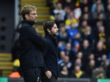 Liverpool manager Jurgen Klopp and his Watford counterpart Quique Flores stand on the touchline on December 20, 2015