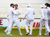 Dale Steyn celebrates with teammates after claiming the wicket of Alex Hales on day one of the first Test between South Africa and England on December 26, 2015