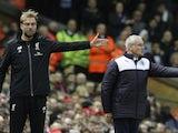 Liverpool manager Jurgen Klopp and his Leicester counterpart Claudio Ranieri practise semaphore on December 26, 2015