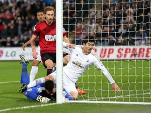 Swansea climb out of relegation zone