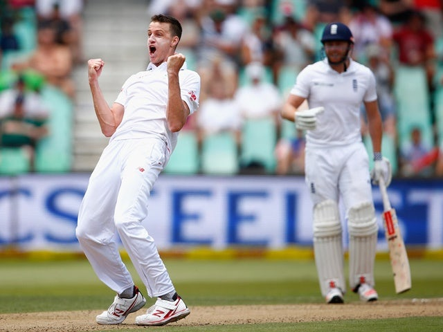 South Africa's Morne Morkel delights in taking the wicket of England's Chris Woakes on December 27, 2015