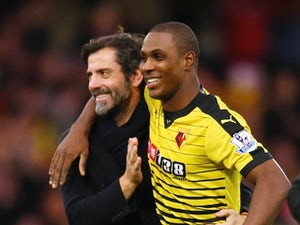 Watford manager Quique Sanchez Flores hugs Odion Ighalo after the 3-0 win over Liverpool on December 20, 2015