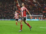 Shane Long celebrates scoring Southampton's fourth against Arsenal on December 26, 2015