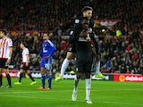 Adam Lallana mounts Christian Benteke after he scores during the game between Sunderland and Liverpool on December 30, 2015