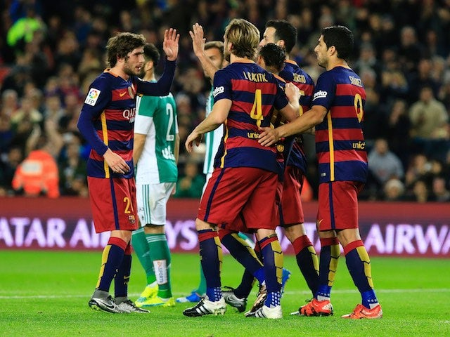 Barcelona players celebrate the first goal during the game with Real Betis on December 30, 2015