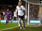 Little Cauley Woodrow celebrates scoring a second for Fulham against Rotherham on December 29, 2015