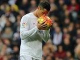 Cristiano Ronaldo kisses the ball before taking a penalty during the game between Real Madrid and Real Sociedad on December 30, 2015