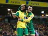Dieumerci Mbokani celebrates scoring Norwich's second against Aston Villa on December 28, 2015