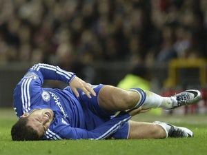 Eden Hazard clutches his shin during the game between Manchester United and Chelsea on December 28, 2015