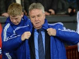 Guus Hiddink wraps up warm during the game between Manchester United and Chelsea on December 28, 2015