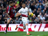 Inigo Martinez and Karim Benzema in action during the game between Real Madrid and Real Sociedad on December 30, 2015
