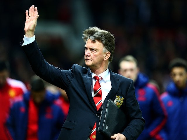 Louis van Gaal acknowledges the home crowd prior to the game between Manchester United and Chelsea on December 28, 2015