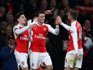 Mesut Ozil celebrates scoring his side's second during the game between Arsenal and Bournemouth on December 28, 2015