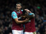 Goal scorers Michail Antonio and huge Andy Carroll celebrate during West Ham's win over Southampton on December 28, 2015