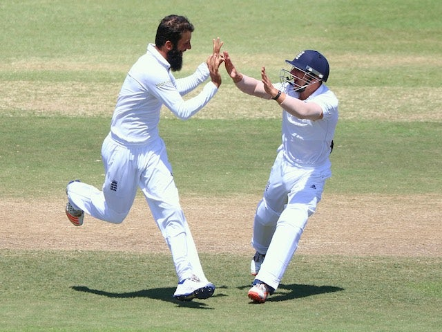 England bowler Moeen Ali celebrates a wicket on day five of the first Test against South Africa in Durban on December 30, 2015