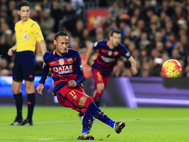Neymar kicks a penalty during the game between Barcelona and Real Betis on December 30, 2015