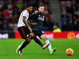 Patrick van Aanholt and Adam Lallana in action during the game between Sunderland and Liverpool on December 30, 2015