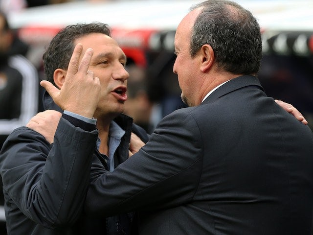 Real Madrid manager Rafa Benitez manhandles his Real Sociedad counterpart Eusebio Sacristan on December 30, 2015