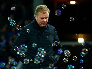 Ronald Koeman is forever blowing bubbles during the game between West Ham and Southampton on December 28, 2015
