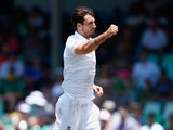 A celebratory Steven Finn in action on day three of the first Test between South Africa and England on December 28, 2015