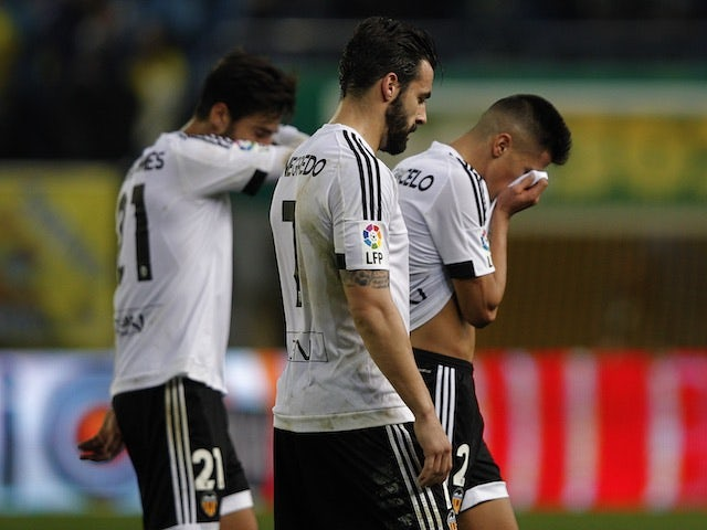 Valencia players dry their eyes after the game between Villarreal and Valencia on December 31, 2015