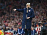 Arsene Wenger and his oversized coat in action during the FA Cup game between Arsenal and Sunderland on January 9, 2016