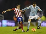 Augusto Fernandez and Iago Aspas in action during the game between Celta Vigo and Atletico Madrid on January 10, 2016