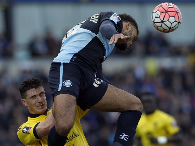 Aston Villa's Ciaran Clark vies with Wycombe Wanderers' Aaron Amadi-Holloway during the FA Cup third-round match at Adams Park on January 9, 2016