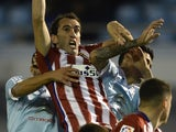 Diego Godin is violated from all angles during the game between Celta Vigo and Atletico Madrid on January 10, 2016