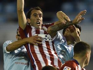 Report: Godin to return for Atletico