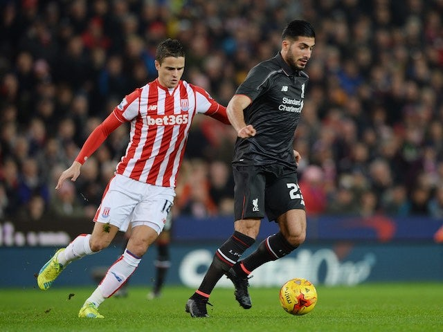 Emre Can and Ibrahim Afellay in action during the League Cup semi-final between Stoke and Liverpool on January 5, 2016