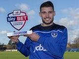 Gareth Evans of Portsmouth poses with his Player of the Month award for December 2015