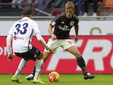 Keisuke Honda and Matteo Brighi in action during the game between AC Milan and Bologna on January 6, 2016
