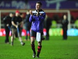 Lee Holmes of Exeter City applauds the crowd as they draw with Liverpool at St James Park in the FA Cup third round on January 8, 2016