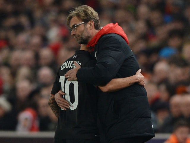 Philippe Coutinho receives a hug from manager Jurgen Klopp after coming off during the League Cup semi-final between Stoke and Liverpool on January 5, 2016