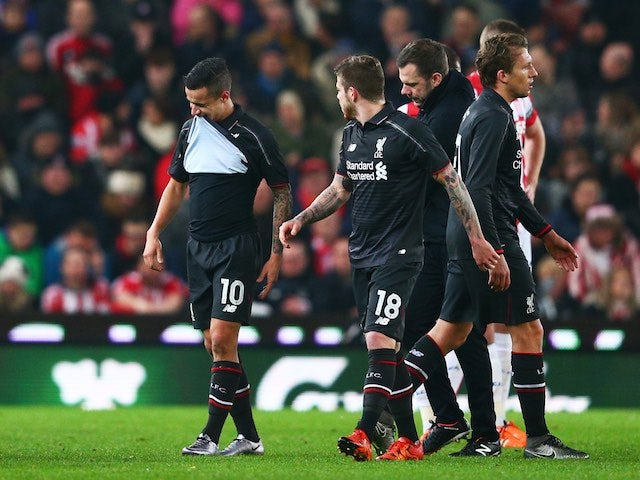 Philippe Coutinho is forced off during the League Cup semi-final between Stoke and Liverpool on January 5, 2016