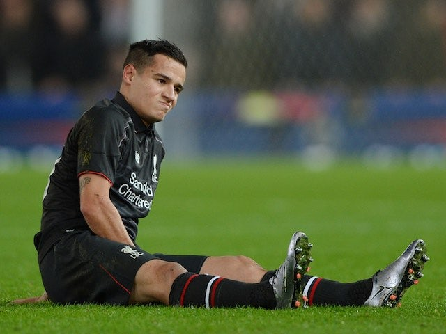 Philippe Coutinho sits injured during the League Cup semi-final between Stoke and Liverpool on January 5, 2016
