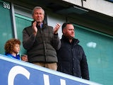 Chelsea owner Roman Abramovich applauds from the stand the FA Cup third-round match against Scunthorpe United at Stamford Bridge on January 10, 2016